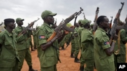 FILE - South Sudanese rebel soldiers raise their weapons at a military camp in the capital Juba, South Sudan, April 7, 2016. Some 750 of them are now on DRC territory.