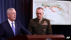 Defense Secretary Jim Mattis, left, and Joint Chiefs Chairman Gen. Joseph Dunford participate in a news conference at the Pentagon, May 19, 2017.