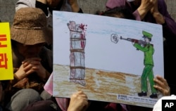 FILE - A drawing depicts a public execution of a North Korean soldier during a human rights rally in Seoul, South Korea, April 14, 2011.