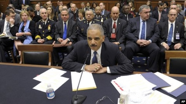 Attorney General Eric Holder, with local law enforcement officers behind him, including Baltimore Police Commissioner Frederick H. Bealefeld, third from left, and Philadelphia Police Commissioner Charles Ramsey, center, prepares to testify on Capitol Hill