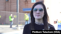 A Thai American first-time voter, Kajornpart Srisuda talks with VOA Thai at a polling station on Election Day in Springfield, VA, U.S., November 3, 2020.