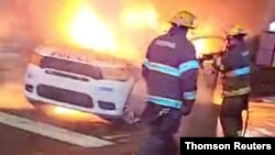 Police vehicle burns during protests after police shooting death of Wallace Jr. in Philadelphia, Pennsylvania