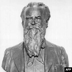 "This bronze bust of John Wesley Powell reads ""Solider, Teacher, Explorer, Geologist, Conservationist, Ethnologist, and Director of the USGS 1881-1894"""