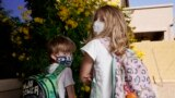 Angela Black, right, with her brother Luke Black at their home, pose for a photo Tuesday, May 11, 2021, in Mesa, Ariz. (AP Photo/Ross D. Franklin)