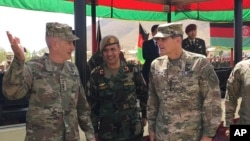 FILE - In this Aug. 20, 2017, photo, U.S. Gen. John Nicholson, top U.S. commander in Afghanistan, from left, talks with Col. Khanullah Shuja, commander of the Afghan special operations force, and U.S. Gen. Joseph Votel, head of U.S. Central Command, at Camp Morehead in Afghanistan.
