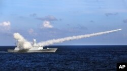 FILE - In this Friday, July 8, 2016, file photo released by Xinhua News Agency, Chinese missile frigate Yuncheng launches an anti-ship missile during a military exercise in the waters near south China's Hainan Island and Paracel Islands.