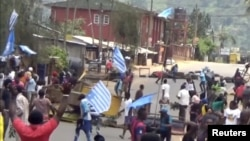 FILE - Protesters wave Ambazonian flags at a roadblock in the English-speaking city of Bamenda, Cameroon, Oct. 1, 2017. Ambazonia is a self-declared state consisting of the Anglophone portions of Cameroon.