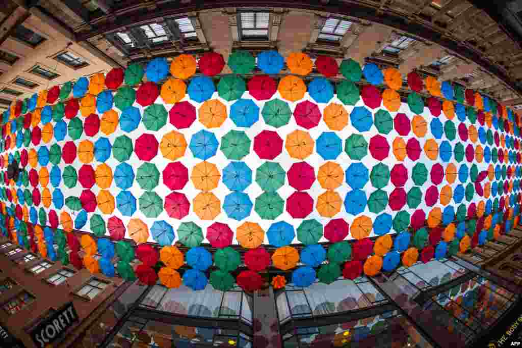 The Umbrella Project, an art installation of colorful umbrellas, is pictured over Drottninggatan shopping street in central Stockholm, Oct. 8, 2020.