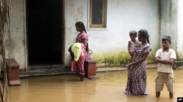 FILE - Monsoon rains hit Sri Lanka, hurting families and farmers.