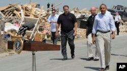 President Barack Obama tours tornado-damaged areas of Vilonia, Arkansas, May 7, 2014.
