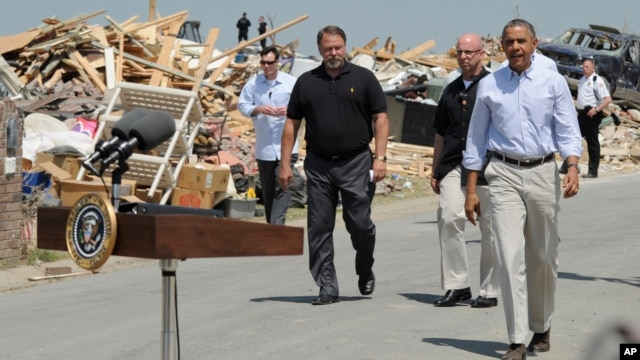 President Barack Obama tours tornado-damaged areas of Vilonia, Arkansas, May 7, 2014.