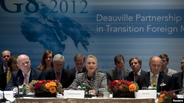 British Foreign Minister William Hague (L) and French Foreign Minister Laurent Fabius (R) listen as U.S. Secretary of State Hillary Clinton speaks during the G8 Deauville Partnership with Arab Countries in Transition meeting in New York, September 28, 201