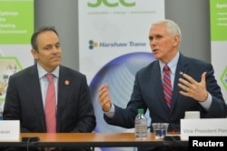 Vice President Mike Pence, sitting with Kentucky Governor Matt Bevin, discusses the Republican replacement for the Affordable Care Act during a meeting with local business leaders in Louisville, Kentucky, March 11, 2017.