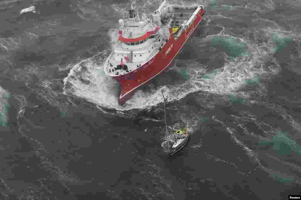 Research vessel Thor Magni rescues two people aboard a racing yacht in high seas in the mid-Atlantic, 250 nautical miles east of St. John's, Newfoundland , Canada, June 10, 2017. (Courtesy: JTFA/Canada Armed Forces)