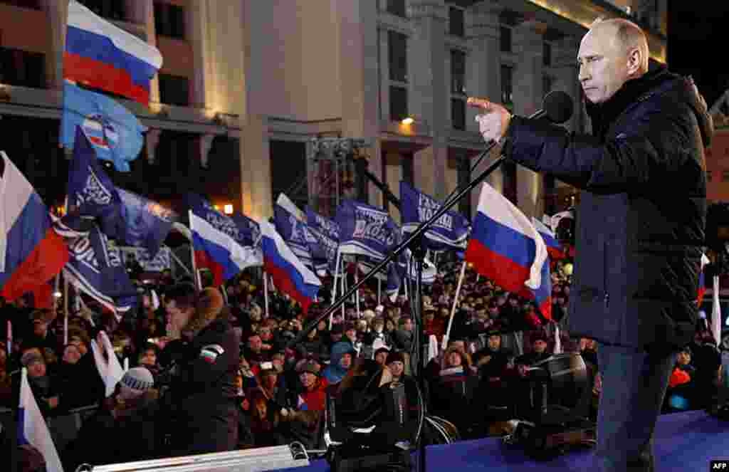 Russian Prime Minister Vladimir Putin, who claimed victory in Russia's presidential election, speaks at a rally of his supporters outside the Kremlin, in Moscow, Russia, March 4, 2012. (AP)