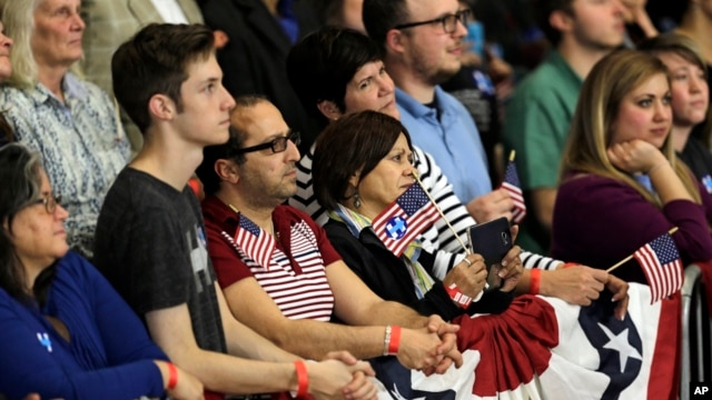 Supporters watch as Democratic presidential candidate Hillary Clinton speaks during a rally at Cuyahoga Community College, in Cleveland, March 8, 2016.