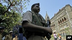 A policeman stands guard outside the Bombay High Court before the delivery of a judgement for Mohammad Ajmal Kasab, Mumbai, February 21, 2011