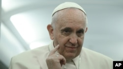 FILE - Pope Francis says the Catholic Church promotes 'responsible parenthood and natural methods of birth control.'