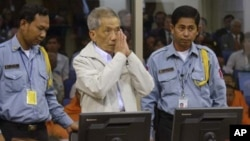 FILE - Former Khmer Rouge S-21 prison chief Duch (C) greets the court during his appeal hearing at the Court Room of the Extraordinary Chambers in the Courts of Cambodia (ECCC) on the outskirts of Phnom Penh, Feb. 3, 2012.