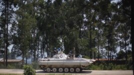 A UN Organization Stabilization Mission in DRC, MONUSCO, armored vehicle drives through Rutshuru, under control of M23 rebels, north of Goma, August 4, 2012.