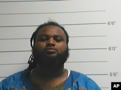 A photo provided by the Orleans Parish Sheriff's Office shows Cardell Hayes, whom police have charged with second-degree murder in the shooting death Saturday of former New Orleans Saints defensive end Will Smith.