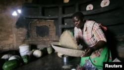 A woman prepare sorghum for food at her home in drought-hit Masvingo, Zimbabwe. (Reuters)