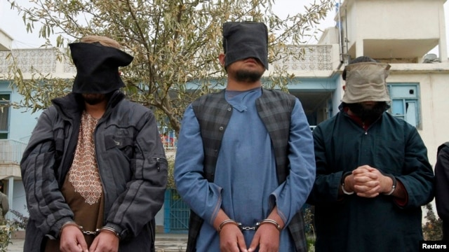 Captured Taliban insurgents are presented to the media in Kandahar province, Afghanistan, Jan. 7, 2014.