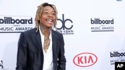 Wiz Khalifa arrives at the Billboard Music Awards at the MGM Grand Garden Arena, May 17, 2015, in Las Vegas.