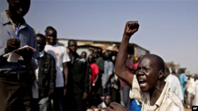 A southern Sudanese man chants pro-independence slogans outside a polling station in the southern capital of Juba Sunday, Jan. 9, 2011