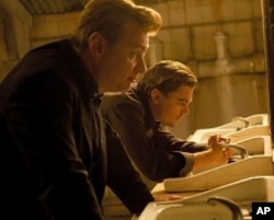 "Director CHRISTOPHER NOLAN with LEONARDO DiCAPRIO on the set of Warner Bros. Pictures' and Legendary Pictures' sci-fi action film ""INCEPTION,"" a Warner Bros. Pictures release."