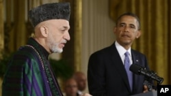 President Barack Obama listens as Afghan President Hamid Karzai speaks during a news conference in the East Room at the White House in Washington, January 11, 2013.
