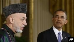 Barack Obama et Hamid Karzai en 2013.
