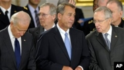 FILE - From left: Vice President Joe Biden, Senate Minority Leader Mitch McConnell, House Speaker John Boehner, Senate Majority Leader Harry Reid, Capitol Rotunda, Washington, Dec. 20, 2012.
