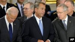 FILE - From left: Vice President Joe Biden, Senate Minority Leader Mitch McConnell, House Speaker John Boehner, Senate Majority Leader Harry Reid, Capitol Rotunda, Washington, Dec. 20, 2012.