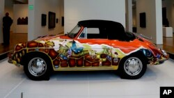 "FILE - 1965 Porsche Type 356 C Cabriolet that once belonged to Janis Joplin on display in the ""Porsche By Design Seducing Speed"" exhibit at the North Carolina Museum of Art in Raleigh, North Carolina."