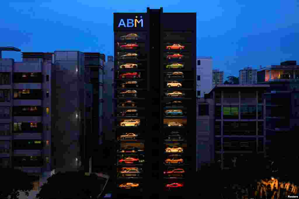 A used car dealership designed to look like a vending machine is seen in Singapore. The dealership houses up to 60 exotic cars in a 15-story building. It uses a fish-bone type lift system to deliver cars to clients within minutes.