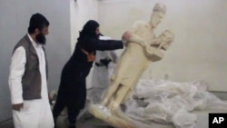 A video from the Islamic State group purports to show militants destroying ancient artifacts in Iraq's Mosul Museum. It was released Feb. 26, 2015.
