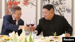 FILE - South Korean President Moon Jae-in makes a toast with North Korean leader Kim Jong Un during a luncheon at Samjiyon Guesthouse in Ryanggang province, North Korea, Sept. 20, 2018.