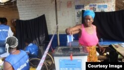 FILE - A woman votes in Liberia's Special Senatorial election.