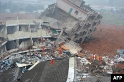 Rescuers look for survivors after a landslide hit an industrial park in Shenzhen, south China's Guangdong province on Dec. 20, 2015.