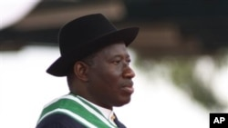 Nigeria President Goodluck Jonathan watches Nigeria troops parade during his inauguration ceremony at the main parade ground in Nigeria's capital of Abuja, May 29, 2011