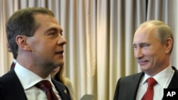 Russian President Vladimir Putin, right, and Prime Minister Dmitry Medvedev attend United Russia party annual congress, Moscow, May 26, 2012.