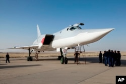 FILE - A Russian Tu-22M3 stands on the tarmac at an air base near Hamedan, Iran, Aug. 15, 2016. Russian warplanes used the base to target Islamic State fighters and other militants in Syria.