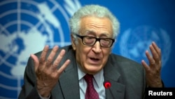 FILE - U.N. mediator for Syria Lakdar Brahimi gestures during a press briefing at the United Nations headquarters in Geneva, Switzerland, January 2014.