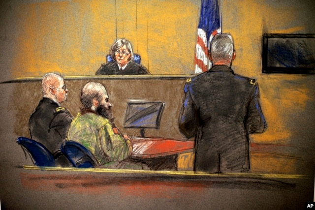 In this courtroom sketch, Maj. Nidal Hasan, center, sits before the judge, U.S. Army Col. Tara Osborn, during the sentencing phase of his trial, Aug. 26, 2013, in Fort Hood, Texas.