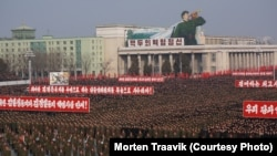 "North Koreans attend a rally to support a statement by a spokesman for the Supreme Command of the Korean People's Army vowing to cancel the 1953 cease-fire that ended the Korean War as well as boasting of the North's ownership of ""lighter and smaller nukes"" and its ability to execute ""surgical strikes."" March 7, 2013."