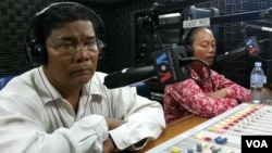Chan Soveth, left, deputy chief of investigation at the rights group Adhoc, and Um Sophy, right, a village representative, from Kampong Chhnang province.
