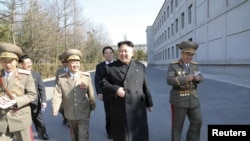 FILE - North Korean leader Kim Jong Un (C) visits the Kim Il Sung University in March 2014. Nobel Prize winners will visit the North's top universities to give speeches and hold workshops in May 2016.