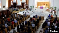 FILE - Catholics attend Mass at a church in Taipei, Taiwan, March 11, 2018.