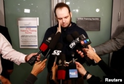 Joshua Boyle speaks to the media after arriving with his wife and three children at Toronto Pearson International Airport, nearly five years after he and his wife were abducted in Afghanistan in 2012 by the Taliban-allied Haqqani network, in Toronto, Oct.